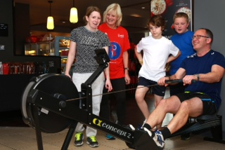 Pupils and staff from Nigel Bowes Academy took part in a fundraising triathlon at The Village Hotel in Bournemouth. Headteacher James Frentzen gets some encouragement on the rowing machine.
