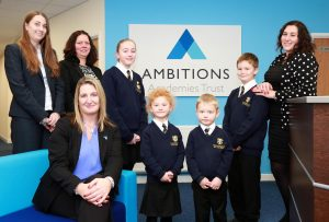 Ambitions Academies Trust Director of Primary Education Alex Prout pictured with pupils and Associate Principals Sarah Rempel of Manorside Academy, Sarah Simmons of Queens Park Academy and Lauren Dean of Kings Park Academy.