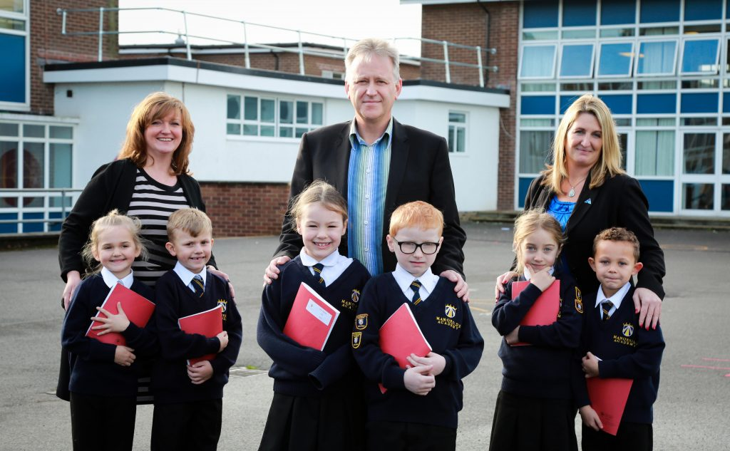 Former Ambitions Academies Trust Brian Hooper who has been made an OBE with Director of Primary Education Alex Prout and Director of Special Education Nicki Morton who have both been made National Leaders of Education. Pictured with pupils from Manorside Academy.